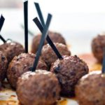18 Meat balls on stick with tomato sauce