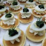 33 Quail Egg with French Cream Caviar on Blinis