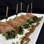 36 Roasted beef rolled with caramelized onion & rocket on stick