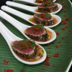 Seared tuna with mango papaya salsa on chinese spoons